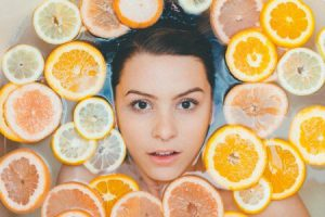a girl surrounded by oranges