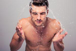 man washing his face